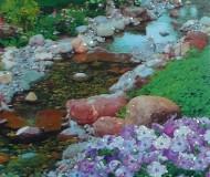Изображение сада с ручьём и цветами